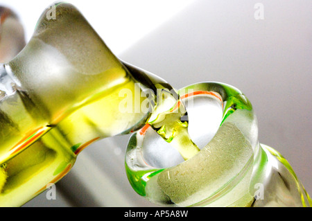 Closeup of liquid pouring into glass beaker in research laboratory setting. - Stock Photo
