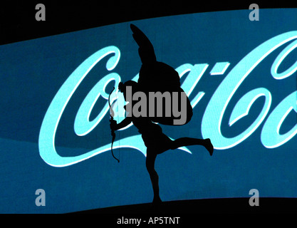 Statue of Eros in front of Coca Cola sign, Piccadilly Circus, London, UK - Stock Photo