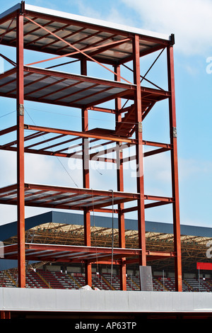 Steel Structure and Construction crane set against a blue sky - Stock Photo