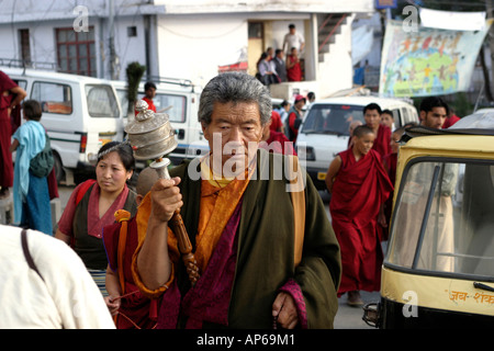 India Himachal Pradesh McLeod Ganj Buddhist Religion Tibetan man spinning prayer wheel - Stock Photo