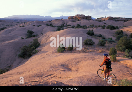 Moab, UT Mountain biking on the Moab Slickrock Bike Trail. Navajo Sandstone. BLM land. - Stock Photo