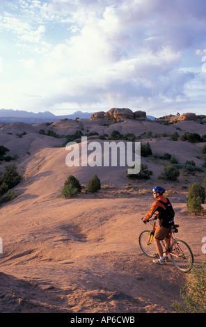 Moab, UT Mountain biking on the Moab Slickrock Bike Trail. Navajo Sandstone. BLM land. - Stock Photo