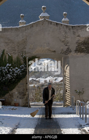 clearing snow from the entrance to Rennaissance castle - Stock Photo