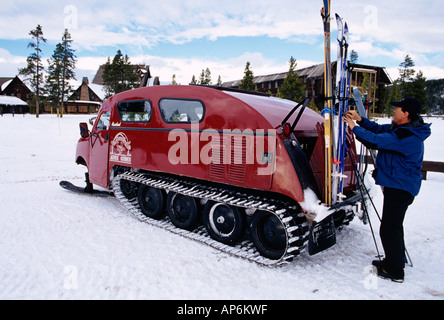 Snowcoach at Old Faithful lodge in Yellowstone National Park - Stock Photo