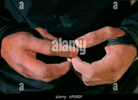 Close up of rock climbers hands with chalk in preparation, Fisher Towers, Colorado,  Utah, USA - Stock Photo