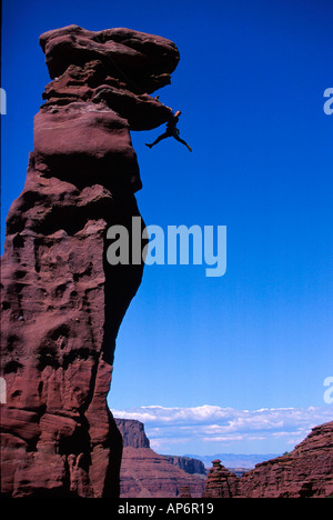Rock climber in difficulty on overhang in Fisher Towers, Colorado River Waterway near Castle Valley in Moab, Utah, - Stock Photo