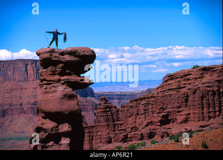 Man preparing abseil in Fisher Towers, Colorado River Waterway Near Castle Valley, Moab, Utah, USA - Stock Photo