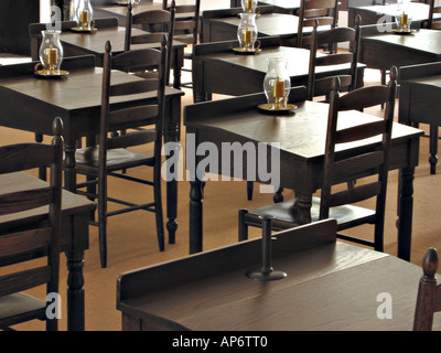 reproduction schoolroom with antique desks - Stock Photo