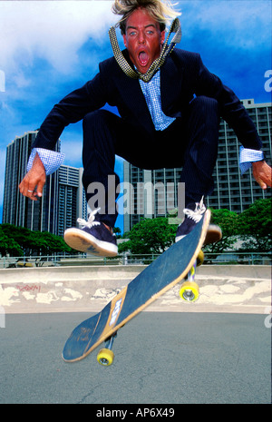 Mam in suit, skateboarding jump, Chuck Patterson, Oahu, Hawaii - Stock Photo