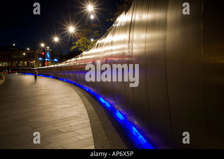 Looking along the side of the Cutting Edge steel sculpture at Sheaf Square Sheffield, England, UK at night - Stock Photo
