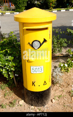 Yellow post box on the Eastern Mediterranean island of Cyprus EU - Stock Photo