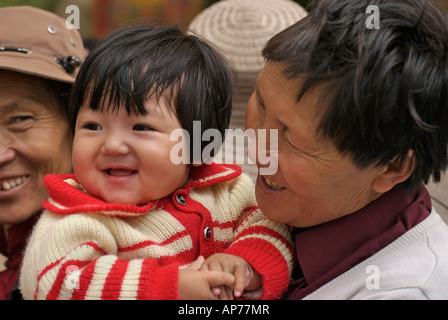 Tibetan grandmother and her happy grandchild Lhasa Tibet - Stock Photo