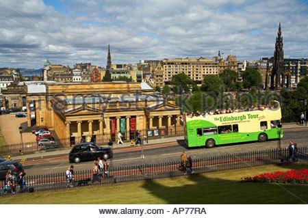 A green tourist bus on The Mound, Edinburgh SCOTLAND - Stock Photo