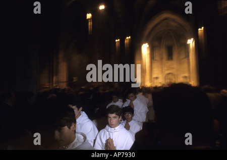 First communion inside Abbey of St. Victor during a Greek Catholic mass, Marseille, France. - Stock Photo