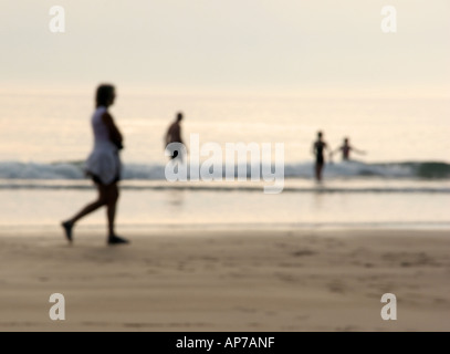 Early evening swim at the beach, Duckpool in Cornwall, north of Bude - Stock Photo