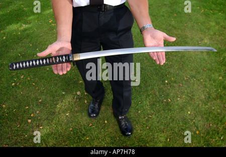 A policeman holding a samurai sword - Stock Photo