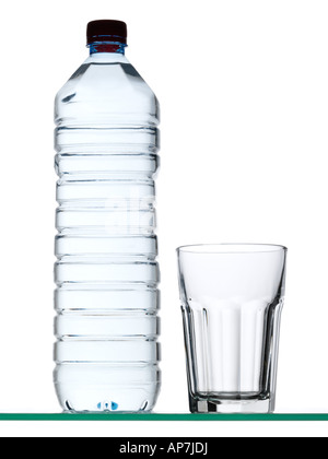Bottle of mineral water and glass - Stock Photo