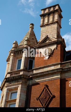 Ornate red brick building and nearby apartments in Mayfair London UK ...
