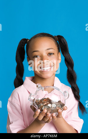 Girl with a piggy bank - Stock Photo
