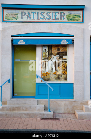 SIGN AND PAINTING ON TILES ON PATISSIER SHOP IN MEURSAULT BURGUNDY WINE REGION FRANCE EUROPE - Stock Photo