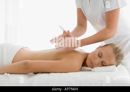 Young woman having back massaged - Stock Photo