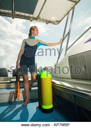 Scuba diver on boat - Stock Photo