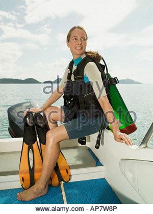 Scuba diver on a boat - Stock Photo