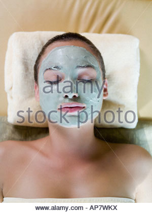 Young woman wearing a face mask - Stock Photo
