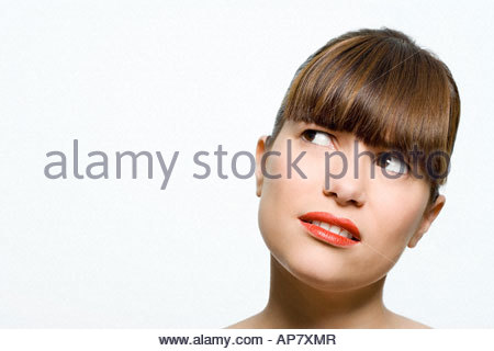 Woman looking confused - Stock Photo