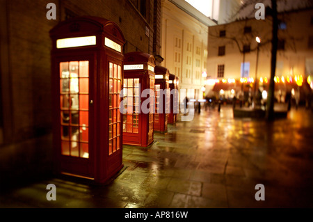A row of British Telephone Boxes in Covent Garden, London - Stock Photo