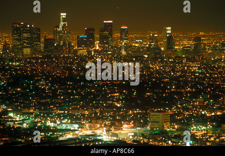 Buildings in city lit up at night, Los Angeles, California, USA - Stock Photo