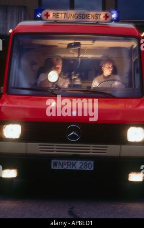 two men sitting in ambulance - Stock Photo