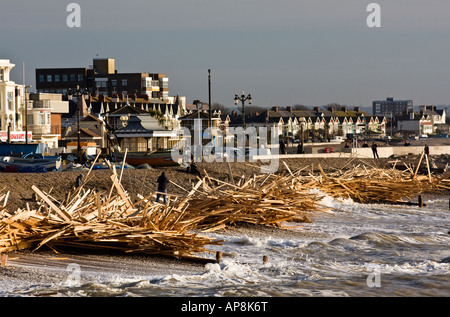 Looking East along the coastline from Worthing Pier. Driftwood from the sunken 'Ice Prince'. Sussex, England, UK. - Stock Photo