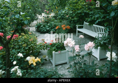 Unique White Garden Furniture And Pink Roses Stock Photo Royalty Free  With Gorgeous  Pink Roses And White Bench In Paved Town Garden With White Planters   Stock Photo With Nice Old Rectory Gardens Cheadle Also Hilliers Garden Centre Bath In Addition What Soil To Use For Raised Vegetable Garden And Monastery Gardens Apartments As Well As Woodland Garden Ideas Additionally Robinhood Gardens From Alamycom With   Gorgeous White Garden Furniture And Pink Roses Stock Photo Royalty Free  With Nice  Pink Roses And White Bench In Paved Town Garden With White Planters   Stock Photo And Unique Old Rectory Gardens Cheadle Also Hilliers Garden Centre Bath In Addition What Soil To Use For Raised Vegetable Garden From Alamycom
