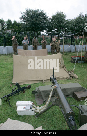 military reinactors train at weapons camp at Grey Point Fort Helens Bay County Down Northern Ireland - Stock Photo