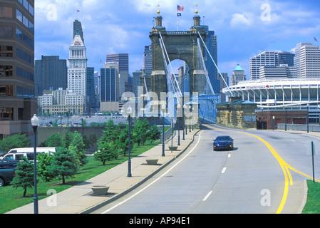 view from Covington Kentucky to Roebling Bridge over Ohio River to Cincinnati Ohio - Stock Photo