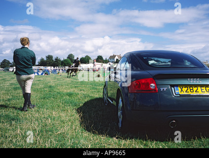 Horse rider watches show jumping competition at Dorchester Show Dorset England - Stock Photo