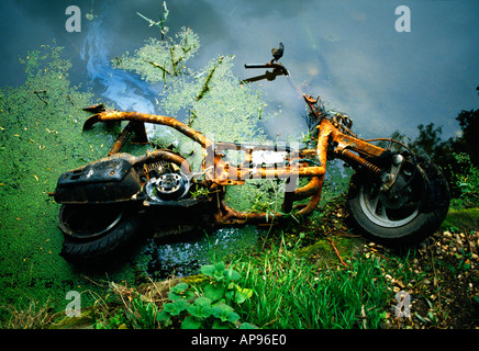 A bike slowly decaying in the water - Stock Photo