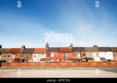 Row of terraced houses with graffiti on the back walls in Liverpool - Stock Photo