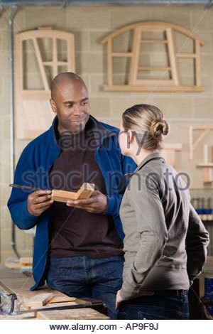 Carpentry student and tutor - Stock Photo