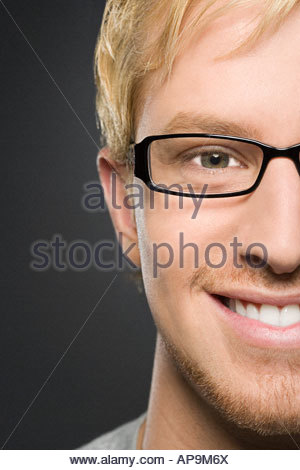 Young man wearing glasses - Stock Photo