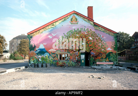 Christiania communal building with 'tree of life' wall painting in Copenhagen, Denmark 1974    KATHY DEWITT - Stock Photo