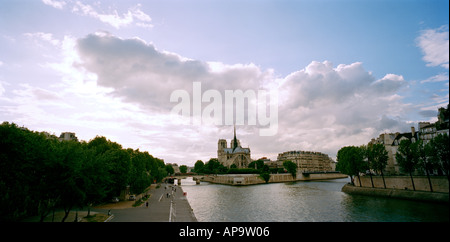 Notre Dame Cathedral and the River Seine in the city of Paris In France In Europe - Stock Photo