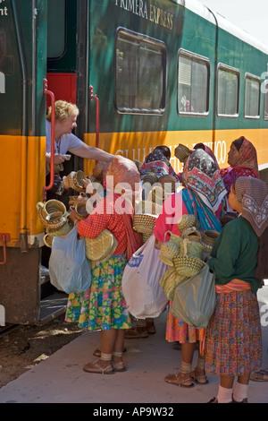 American tourists buying artifacts from native women in San Rafael a town in the Tarahumara Sierra near Creel Mexico - Stock Photo