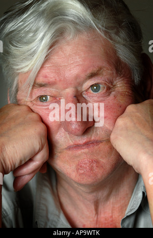 A SENIOR CITIZEN PENSIONER OAP OLD MAN LOOKING FED UP, RE DEPRESSION RETIREMENT RISING COST OF LIVING BILLS LONELY - Stock Photo