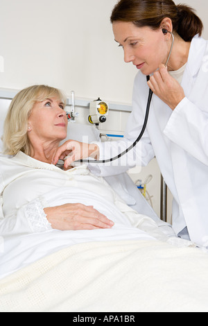 Patient and doctor with stethoscope - Stock Photo