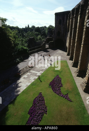 dh Dunfermline Abbey DUNFERMLINE FIFE Dunfermline Palace and Dolphin flower beds with people scotland display