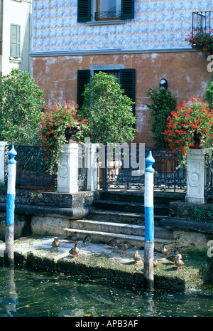 Detail of house whose garden reaches right down to the lake in the town of Lovere on Lago d Iseo Italy - Stock Photo