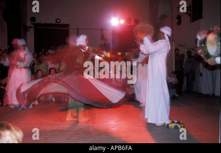 The Al Tannoura Egyptian Heritage Dance Troupe performing traditional Sufi dance in Cairo Egypt Also known as the - Stock Photo