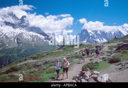 Walkers on the Tour of Mont Blanc above the Chamonix Valley French Alps France - Stock Photo